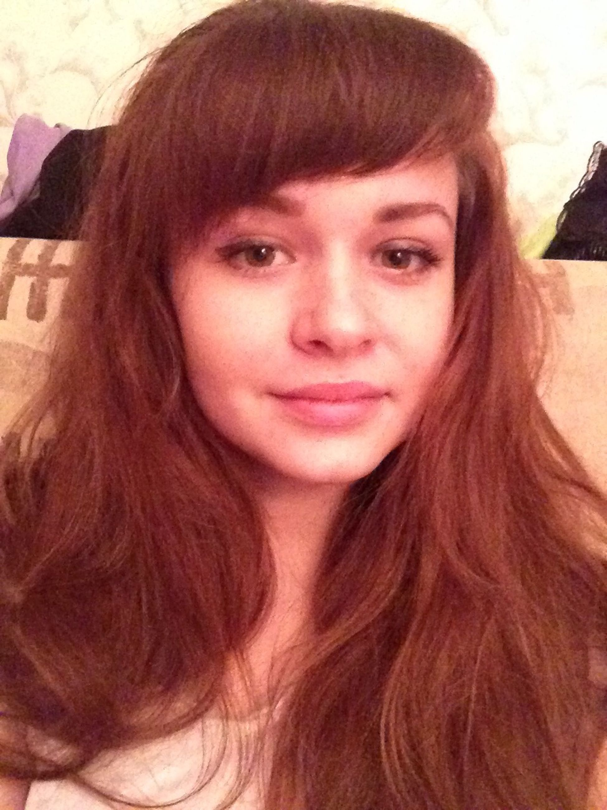 young adult, young women, person, portrait, looking at camera, long hair, headshot, lifestyles, front view, indoors, smiling, leisure activity, brown hair, black hair, close-up, human face, head and shoulders