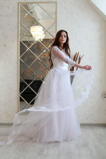 One Person Women Full Length Real People Young Adult Looking At Camera Adult Young Women Portrait Wall - Building Feature Architecture Lifestyles Wedding Celebration Newlywed Beautiful Woman Clothing Fashion Wedding Dress Hairstyle