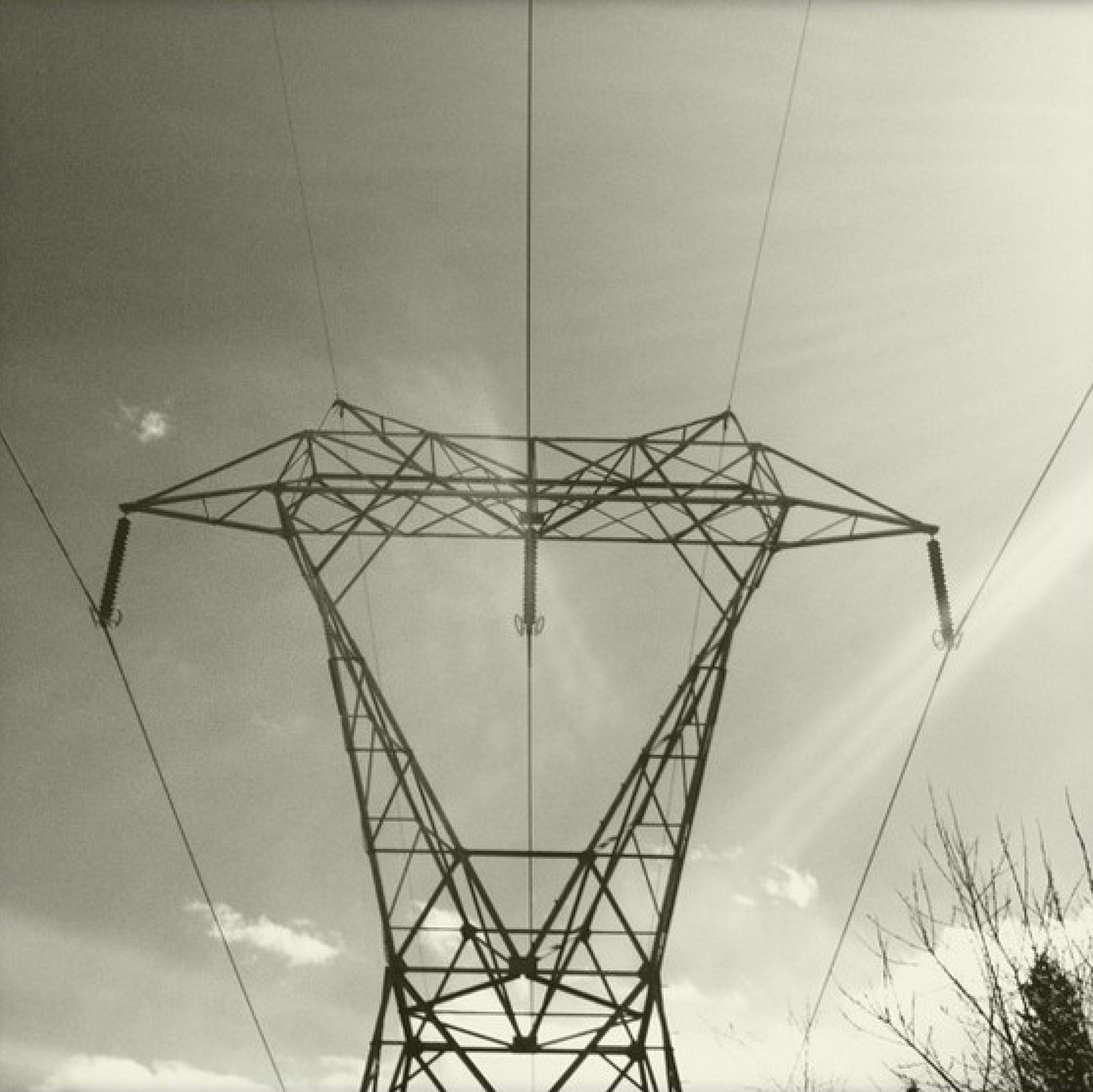 low angle view, sky, power line, electricity, electricity pylon, built structure, power supply, connection, cloud - sky, architecture, silhouette, day, technology, outdoors, no people, cable, directly below, cloud, fuel and power generation, cloudy
