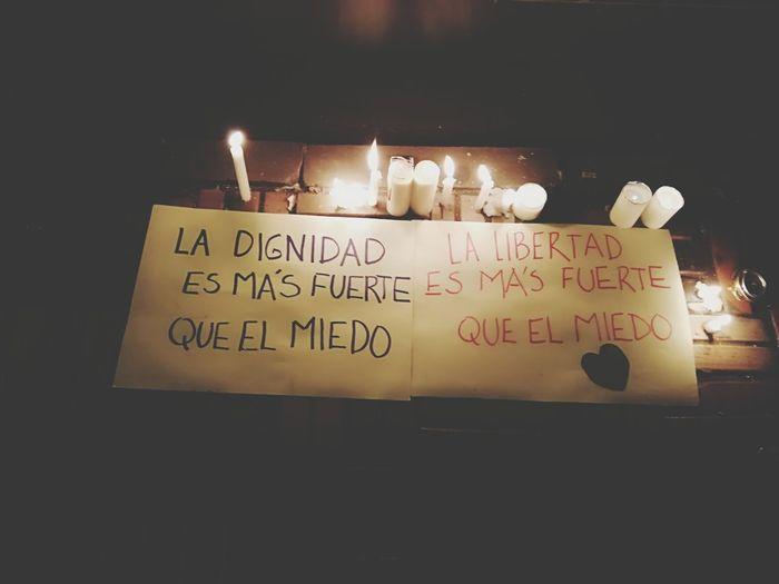 Dignidad Nosestanmatando Unavelaporlavida Communication Celebration Illuminated Message Western Script Close-up Candlelight Candle Handwriting  The Troublemakers