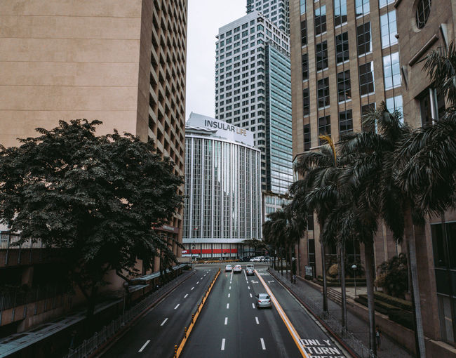 Road amidst buildings in city