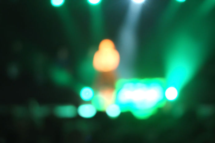 Defocused person performs on stage Singer  Stage Stage Performance Concert Concert Photography Concert Photos Defocused Glowing Green Color Illuminated Lighting Equipment Night Shape Spotlight Superstar