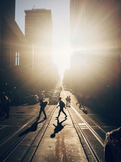 Architecture Building Exterior Built Structure City City Life Day Large Group Of People Lens Flare Men Outdoors People Public Transportation Rail Transportation Railroad Track Real People Sky Sun Sunbeam Sunlight Transportation Women