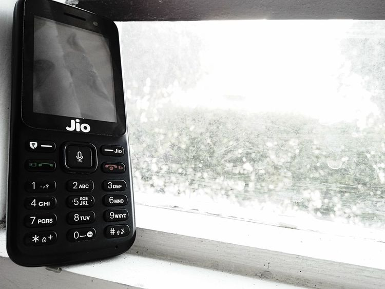 jio phone Jio Phone Jio Phone India Handset Mobile Handset Small Smartphone 4g Smartlhone No People Indoors  Technology Water Day Close-up