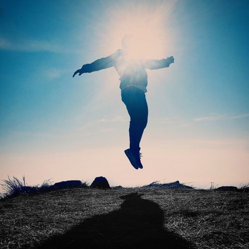 Mid-air Full Length Energetic Sky One Person Sunlight Real People Low Angle View Motion Leisure Activity Silhouette Sunset Jumping Outdoors Lifestyles Front View Sun Nature Day Men