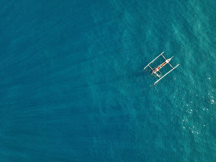 High angle view of outrigger in sea