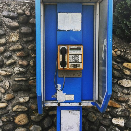 Pay phone on stone wall