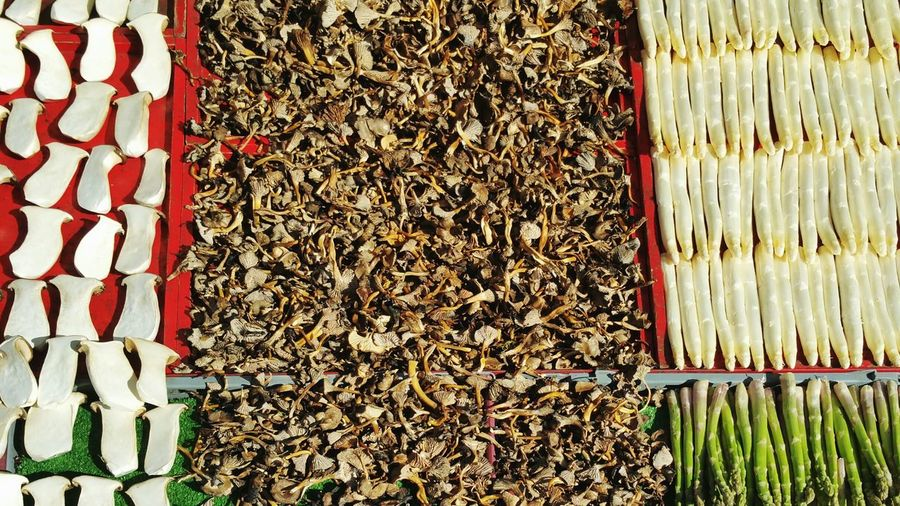 Fresh Vegetables With Dried Mushrooms For Sale At Market Stall