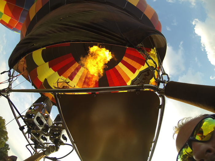 Burning reflections. Low Angle View Sky Cloud - Sky Outdoors Tourism Multi Colored Non-urban Scene Lancaster County Pennsylvania Runridesoar2016 Colors Hot Air Balloon Hot Air Balloons Gopro Transportation Selfie ✌ Unrecognizable Person Reflection Fire Flame Heat Burner Travel Mode Of Transportation Wide Angle Balloon