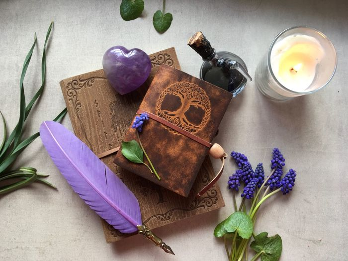 Wicked book Candle Flower Head Flatlayphotography Flatlay Muscari Enchanted  Magic Book Witch Wicked Purple Flowering Plant Flower High Angle View Plant Still Life Nature Table Indoors  No People Lavender Multi Colored Close-up Freshness Art And Craft Decoration Choice Paper