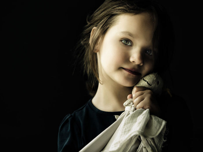 Portrait Of Girl Against Black Background
