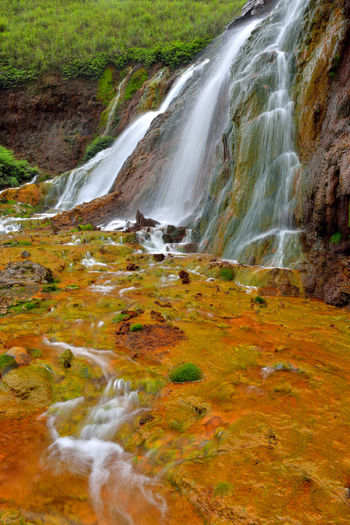 Golden Waterfall is located in Jinguashi, New Taipei City, Taiwan, a scenic tourist area. Cool Golden Golden Waterfall Jinguashi Minerals Scenes Taiwan Beauty In Nature Comfortable Day Fresh Geology Landscape Motion Nature No People Outdoors Scenics Sky Stream Tranquil Scene Tranquility Water Waterfall