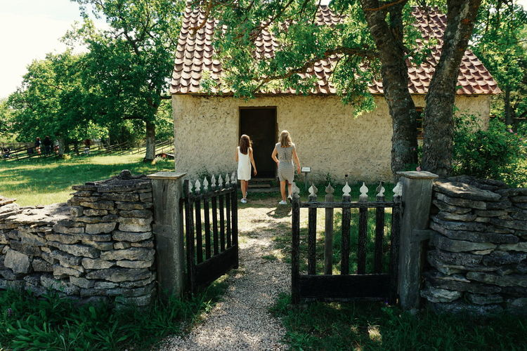 Two Girls and a old house Architecture Building Exterior Built Structure Bunge Bunge Museum Childhood Children Day Girls Gotland Gotland, Sweden Grass Midsommar Midsummer Nature Outdoors People Real People Togetherness Tree Two People Sommergefühle