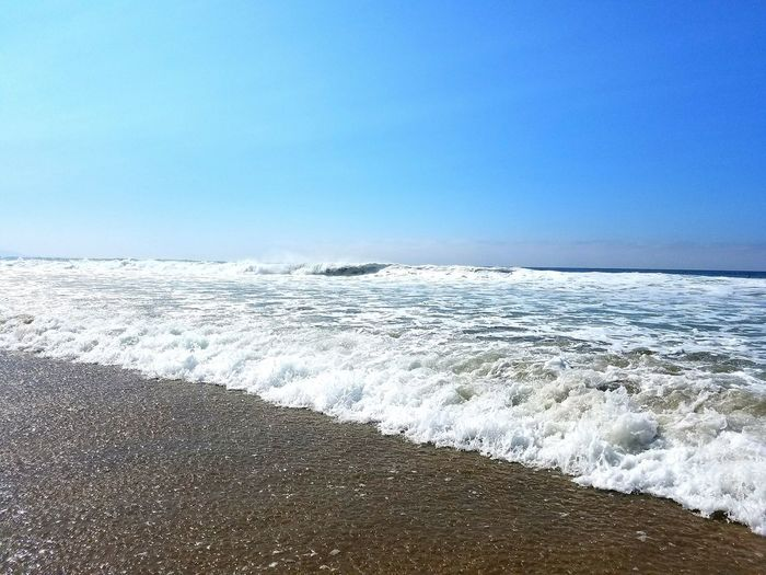 Scenic View Of Wavy Sea Against Clear Sky