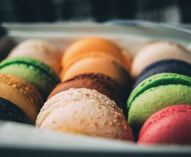 Close-up of multi colored macaroons in box