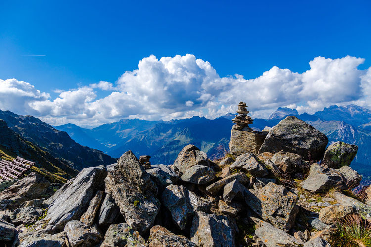 Panoramic View Of Mountains Against Blue Sky