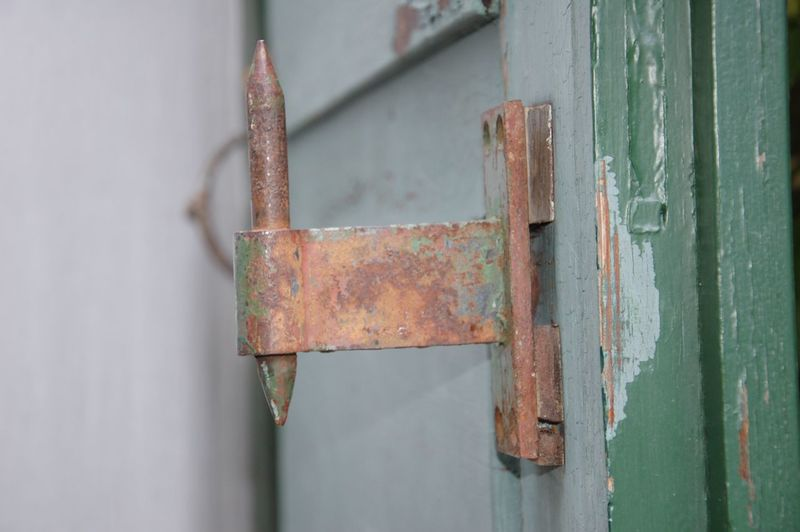 Close-Up Of Rusty Metal On Door