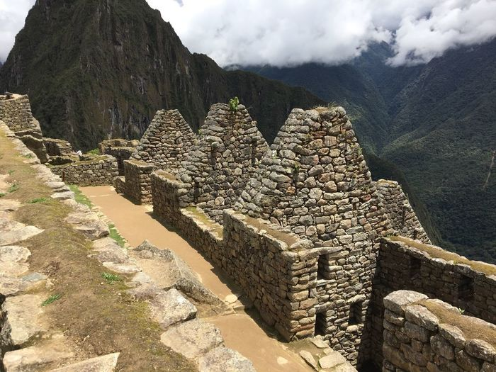 Machu Picchu Mountain History Ancient Mountain Range Day Ancient Civilization Old Ruin Travel Destinations Outdoors Built Structure Nature Architecture No People Sky Building Exterior Beauty In Nature