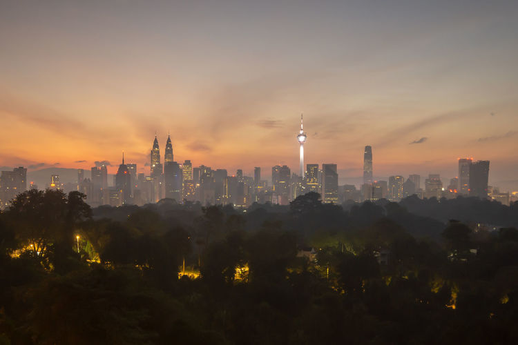 Kuala Lumpur skyline sunrise Architecture Built Structure Building Exterior Building Sky City Tower Cityscape Tall - High No People Office Building Exterior Urban Skyline Skyscraper Sunset Travel Destinations Landscape Nature Outdoors Residential District Modern Pollution Spire