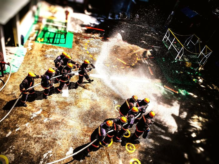 Beat the Heat! Fire FireFighting  Firefighters In Action Gasfire Training Illuminated High Angle View