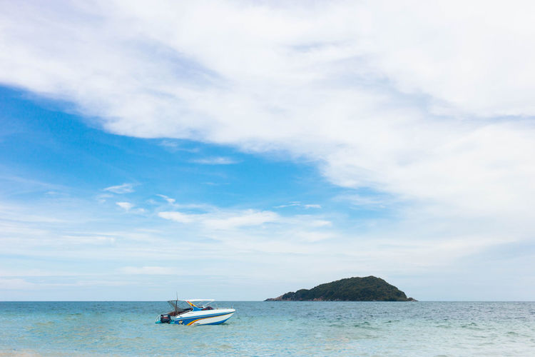Thailand island with speed boat floating on the beach Copy Space Beauty In Nature Cloud - Sky Day Horizon Over Water Nature Nautical Vessel One Person Outdoors People Scenics Sea Selective Focus Sky Tranquility Transportation Water