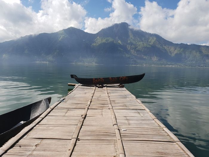Scenic view of pier in lake against sky