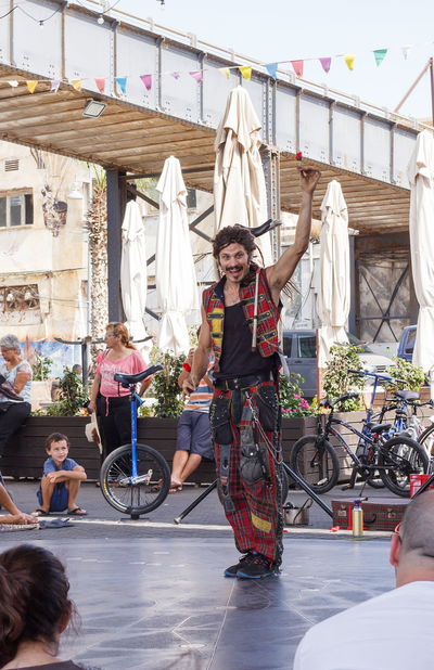 Yafo, Israel, October 15, 2016: Artist shows a representation of the street on the waterfront in Yafo, Israel Actor Adult Advertise Art Artist Costume Creative Culture Day Entertainment Festival Flower Image Israel Outdoors People Performance Person Representation Rosé Show Street Unusual Waterfront Yafo