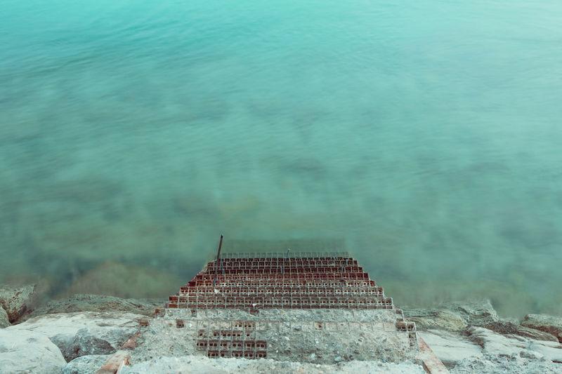 Into the blue Harbor Long Exposure Nature Night No People Ocean Outdoors Rocks Sea Sea And Sky Stairs Water
