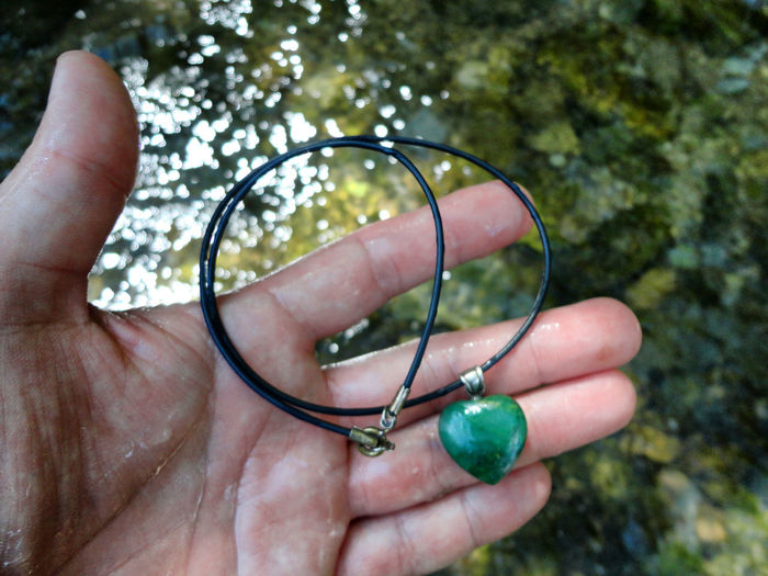 Cropped Image Of Hand Holding Jewelry