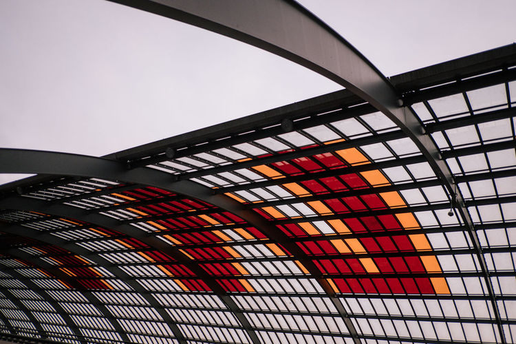 Low Angle View No People Architecture Built Structure Pattern Indoors  Sky Metal Modern Close-up Illuminated Ceiling Glass - Material Nature Day Design Orange Color Multi Colored Architecture And Art