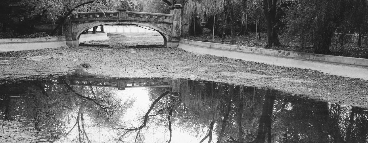 Arch Bridge Over Canal With Reflection