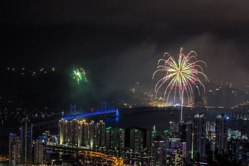 Fireworks Festival in Busan, South Korea. Night Firework Display Celebration City Firework - Man Made Object Sky Exploding Illuminated Architecture Travel Destinations Cityscape Building Exterior Outdoors Water Event Midnight No People Skyscraper Firework