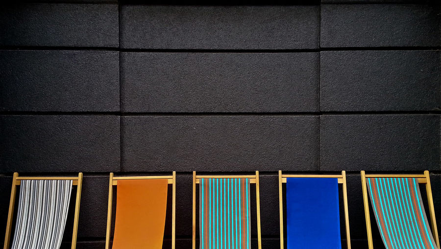 Cropped Deck Chairs Against The Wall