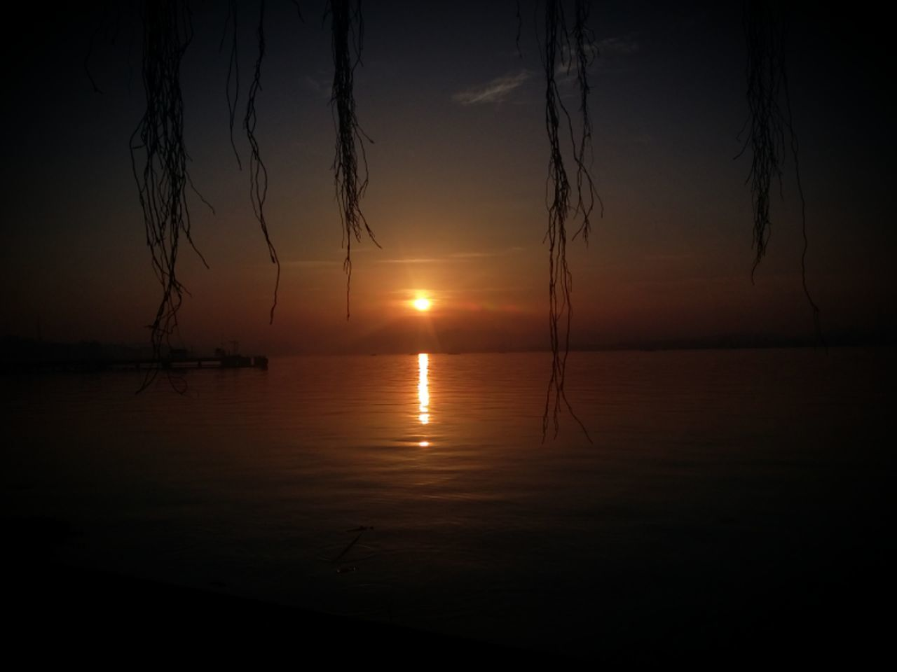 sunset, reflection, tranquility, nature, tranquil scene, scenics, water, beauty in nature, sea, sun, no people, sky, silhouette, outdoors, waterfront