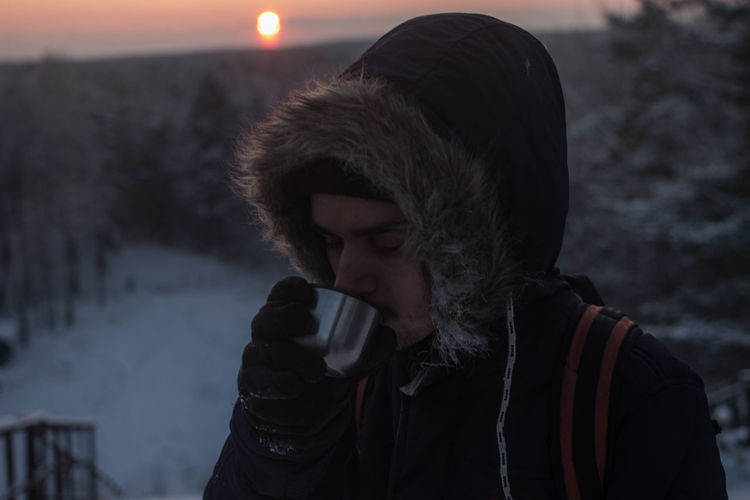 Cold Cold Temperature Drink EyeEmNewHere Freeze Freezing Frost Frosty Headshot Horizon Hot Drink Ice Landscape Looking Down Outdoors People Sky Snow Snow Covered Sunset Tree Warm Clothing Winter Young Adult Young Men