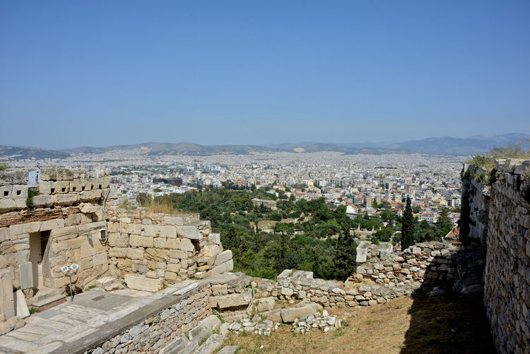 panoramic view of Athens town seen from the Acropolis Architecture Built Structure Building Exterior Sky History The Past Clear Sky City Ancient Travel Destinations Nature Building Tourism Day Copy Space Travel No People Mountain Old Ancient Civilization Outdoors Cityscape Archaeology Stone Wall TOWNSCAPE Athens, Greece Cityscape Panoramic View Archeological Site Acropolis, Athens Ruins Architecture