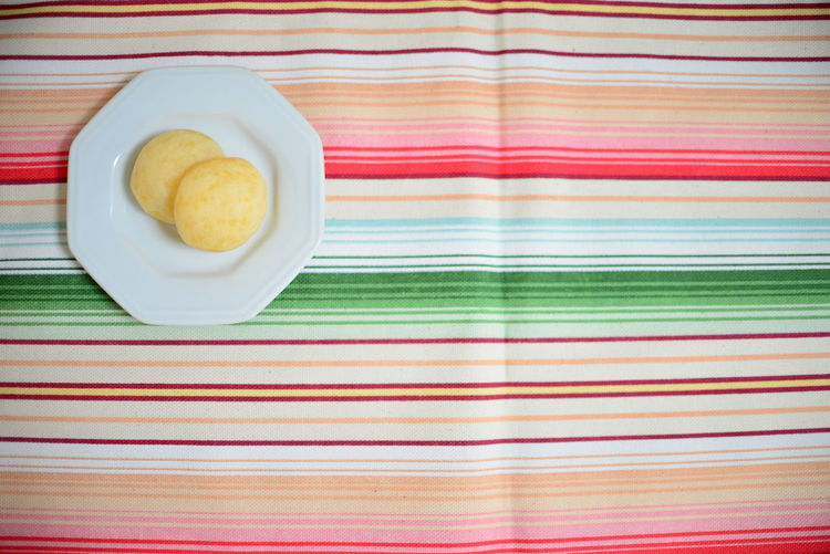 Cheese Bread EyeEm Best Shots Eye4photography  Getting Inspired Food And Drink Cheese Puffs Finger Food Striped Food Tablecloth Indoors  Freshness Still Life No People Directly Above Pattern High Angle View Breakfast Meal Table Textile Ready-to-eat Sweet Food Close-up Colors The Minimalist - 2019 EyeEm Awards The Foodie - 2019 EyeEm Awards