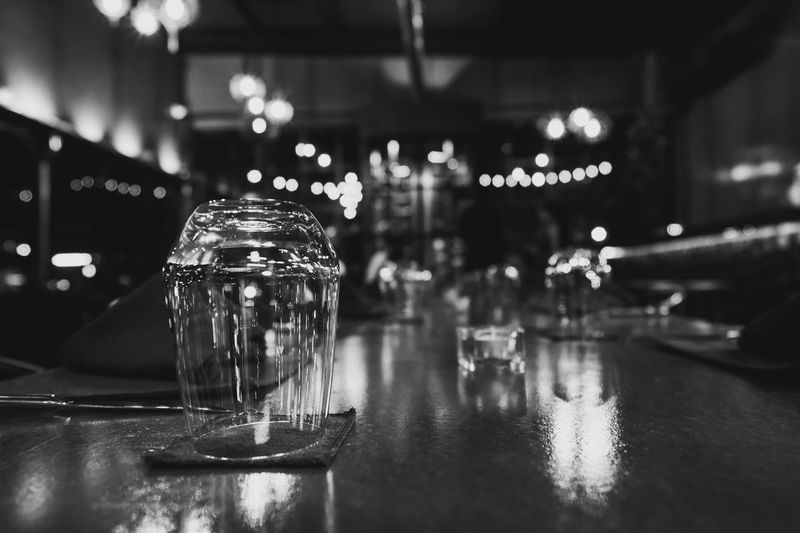 Bar - Drink Establishment Bar Counter Business Close-up Drink Empty Focus On Foreground Food And Drink Glass Glass - Material Household Equipment Illuminated Indoors  Night Nightlife No People Reflection Restaurant Still Life Table Transparent