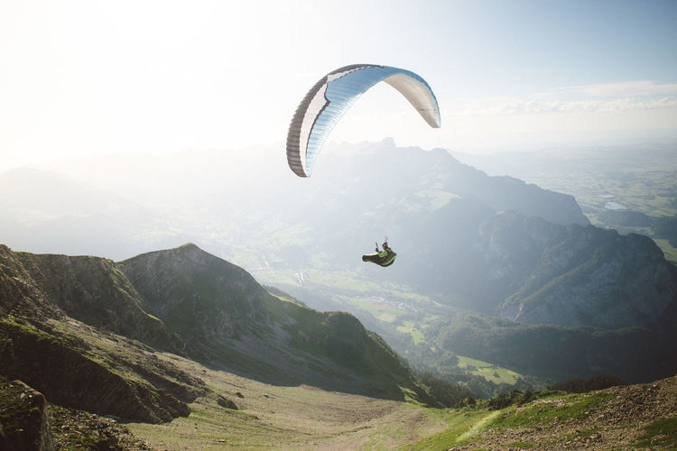Paragliding Paraglider Mountain Adventure Scenics - Nature Sport Parachute Beauty In Nature Extreme Sports Mid-air Mountain Range Flying Non-urban Scene Tranquil Scene Sky Tranquility Nature Environment Leisure Activity Exhilaration Joy Freedom Outdoors