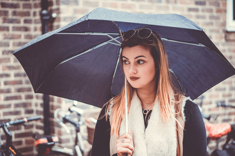 Close-Up Of Beautiful Woman Holding Umbrella