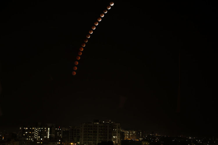 lunar eclipse Night Arts Culture And Entertainment City Firework Display Illuminated Sky Travel Destinations Outdoors Cityscape