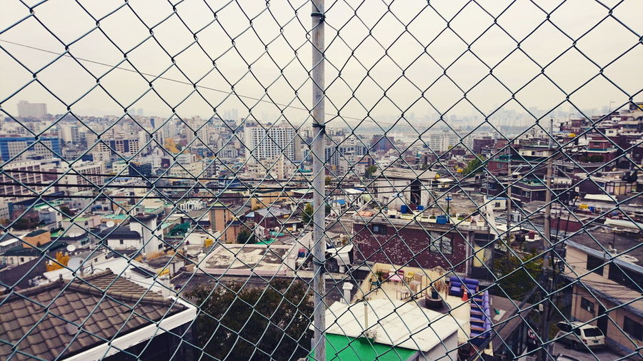Streetphotography Roof Rooftop Hill Mesh Fence Urban Lifestyle Apartment Itaewon Seoul, Korea City Full Frame Backgrounds Sky Close-up Fence Settlement Residential  Cityscape Urban Skyline Skyline Residential District Urban Scene The Street Photographer - 2018 EyeEm Awards EyeEmNewHere The Traveler - 2018 EyeEm Awards The Architect - 2018 EyeEm Awards
