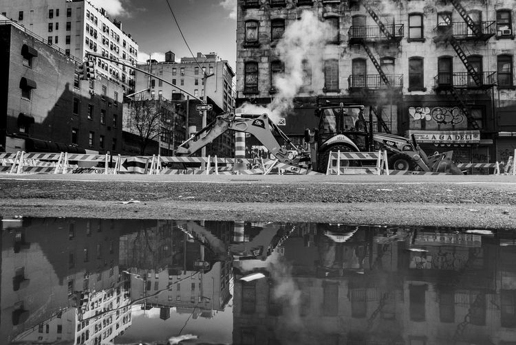 Working in the city. New York Streetphotography Streetphoto_bw Street Photography Built Structure Architecture Building Exterior Reflection Water Transportation Day Building Industry No People Waterfront City Smoke - Physical Structure Mode Of Transportation Nature Pollution Outdoors Connection River Air Pollution