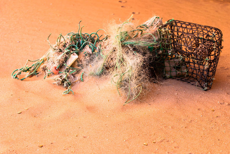 Close-up Fisher Fishernet Lost Things No People fish trap Sand Still Life