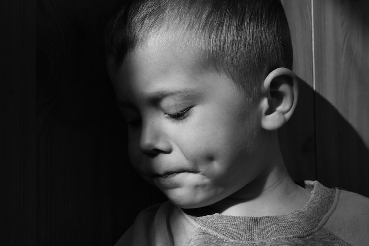 Close-up of boy with closed eyes
