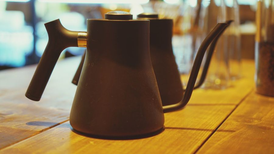 Close-Up Of Teapots On Table