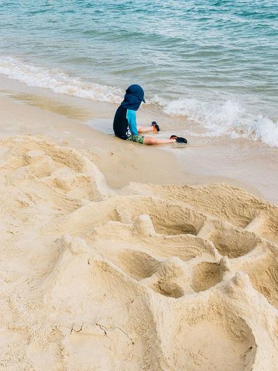High angle view of boy on beach