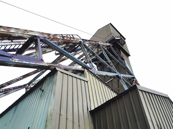 EyeEm Selects Industrial Mining Heritage Mining History Of America Built Structure Low Angle View Building Exterior Architecture No People Day Outdoors Sky Architecture Corrugated Metal Park City, Utah Vintage Historical Building Heritage Silver Mining Truss Mining Tower