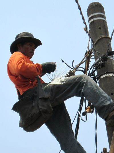 Worker of electricity Only Men One Man Only Adult One Person People Working Manual Worker Full Length Construction Worker Men Outdoors Maintenance Engineer Enginer Electricity  Pylon Power Plant Adults Only Cable