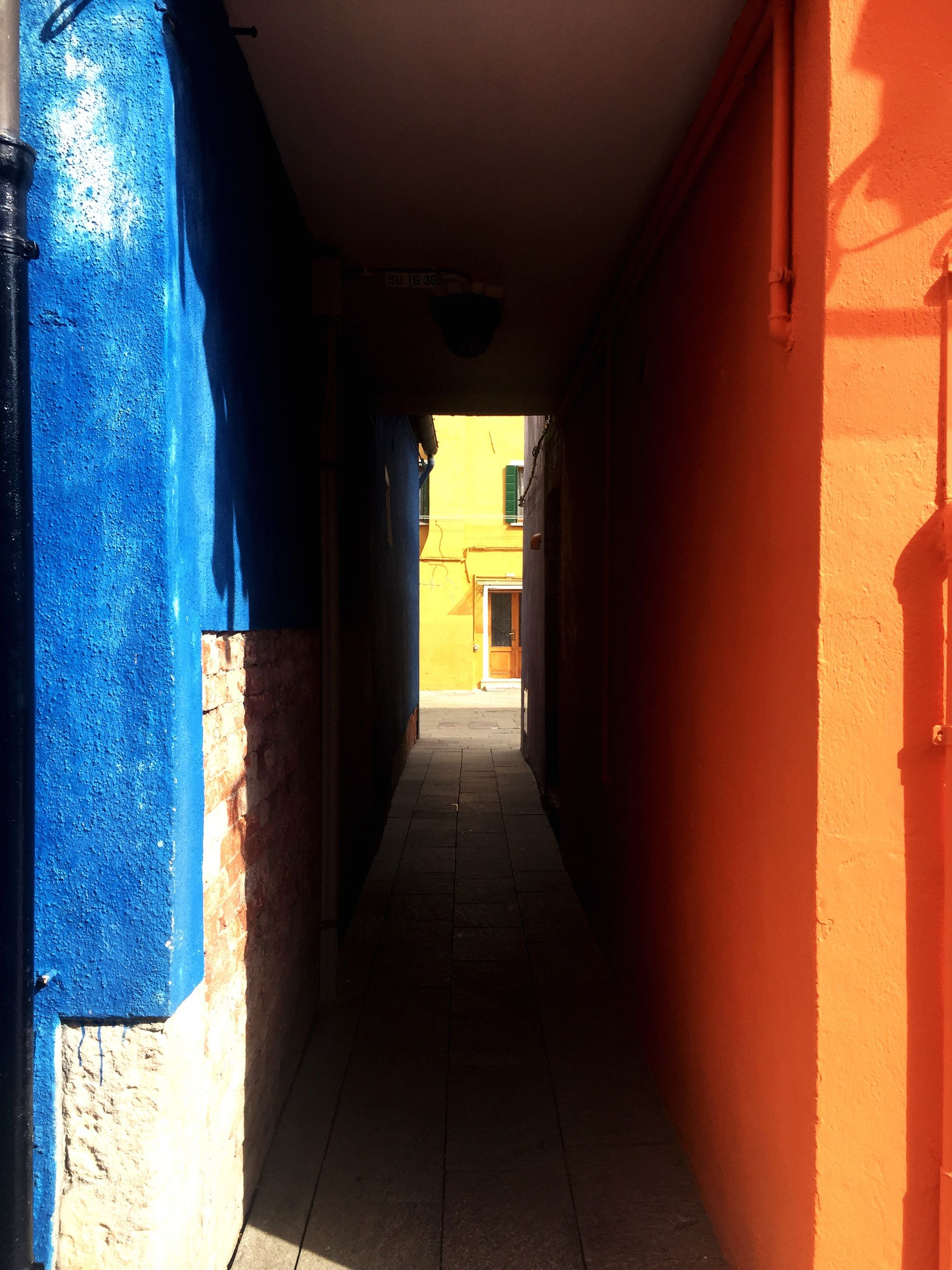 architecture, built structure, the way forward, indoors, corridor, narrow, empty, building exterior, diminishing perspective, door, building, wall - building feature, walkway, long, wall, arch, vanishing point, architectural column, absence, column